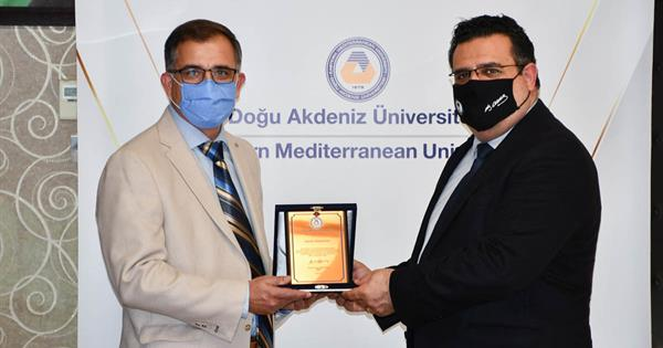 EMU Presents a Plaque to Dr. Mehmet İnan